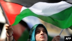 A demonstrator waves a Palestinian flag during an anti-Israeli protest in front of the Israeli Consulate in Istanbul on May 31.