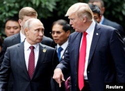 U.S. President Donald Trump and Russian President Vladimir Putin talk at the APEC Summit in Danang, Vietnam, in November.