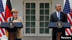 U.S. President Barack Obama (right) and German Chancellor Angela Merkel address a joint news conference in the Rose Garden of the White House in Washington on May 2.
