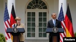 Iамеркан Цхьаьнатоьхна Штаташ -- Iамеркан президент Обама Барак а, немцойн канцлер Меркел Ангела а цхьаьний зобран-конференци луш ду, Вошингтон, 2Сти2014.