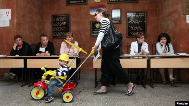 A woman and child at a Yerevan polling station for city elections on May 5