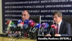 Azerbaijan - Azerbaijani Foreign Ministers Elmar Mammadyarov (L) and his Turkish counterpart Ahmet Davutoğlu during a joint press briefing in Baku, 15Oct2012.