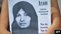 A placard showing Sakineh Mohammadi Ashtiani during a protest in London against her execution