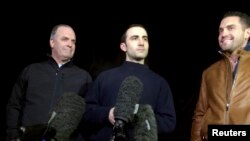Amir Hekmati (center), flanked by U.S. congressman Dan Kildee (left) and brother-in-law Ramy Kurdi, speaks with the media in Landstuhl, Germany, on January 19.