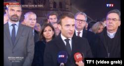 French President Emmanuel Macron speaks in Paris near fire site