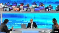 Russian President Vladimir Putin listens to journalists from state television networks during an annual Q&A broadcast nationwide in April.