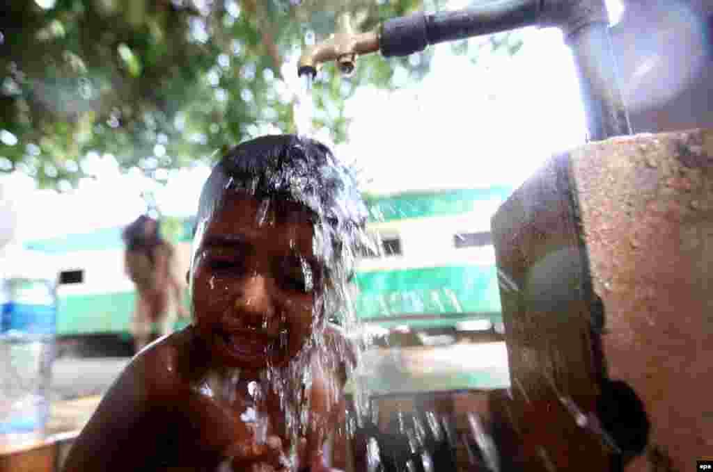 A Karachi boy cools off.