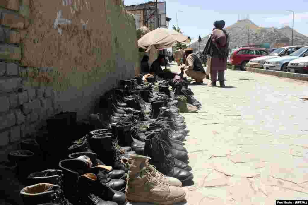 """U.S. military boots being sold outside the """"Obama Bazaar"""" in Kabul."""