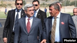 Armenia - President Serzh Sarkisian and businessman Ruben Hayrapetian (R) visit a football academy in Yerevan, 1Sep2010.