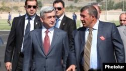 Armenia - President Serzh Sarkisian and businessman Ruben Hayrapetian (R) visit a football academy in Yerevan, 1Sep2010.