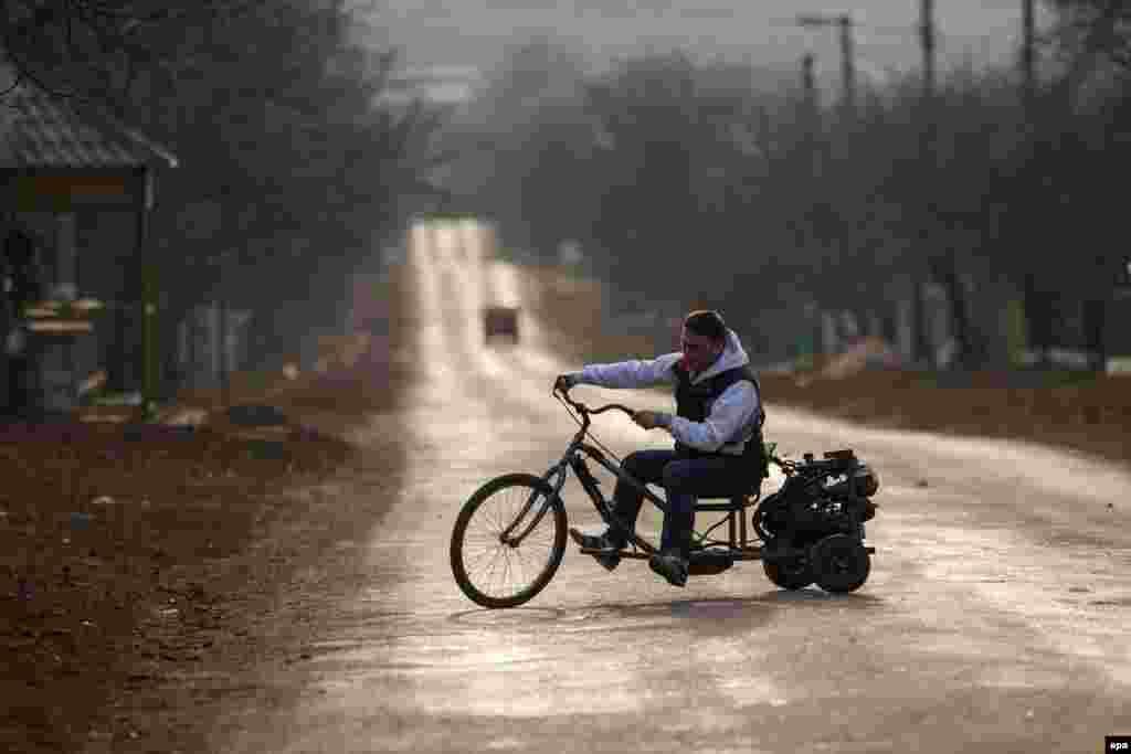 A man tests his handmade motorcycle in the village of Ivancea, near Chisinau, Moldova, on March 7. (epa/Dumitru Doru)