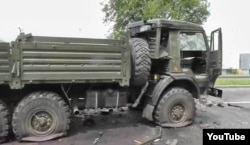 Пошкоджена вантажівка КамАЗ-5350, скрін з проросійського YouTube-каналу «Суть Времени Донецкая Народная Республика»
