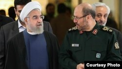 حسن روحانی (سمت چپ) با حسین دهقان، وزیر دفاع ایران.