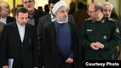 Iranian President Hassan Rohani (center) along with Defense Minister Hossein Dehghan (right) and Chief of Staff Mahmud Vaezi