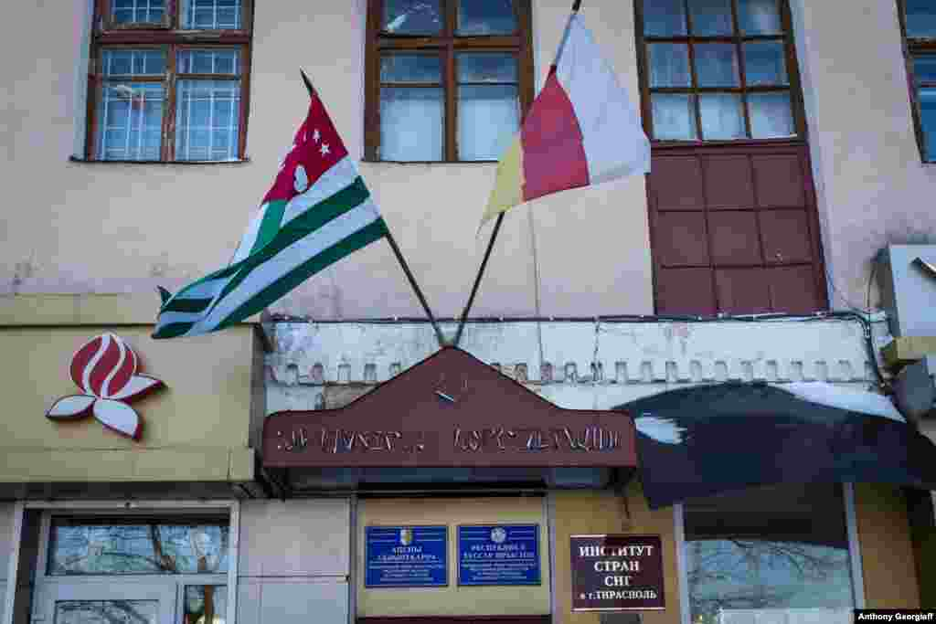 The flags of Georgia's breakaway regions of Abkhazia and South Ossetia fly in front of an office in Tiraspol. Those regions, along with Nagorno-Karabakh, are the only territories that recognize the independence of Transdniester.