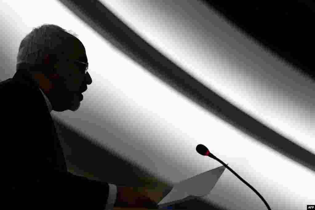 Iranian Foreign Minister Mohammad Javad Zarif is seen in silhouette delivering his speech before delegates on the opening day of a UN Human Rights council session at the United Nations offices in Geneva on March 2. (AFP/Fabrice Coffrini)