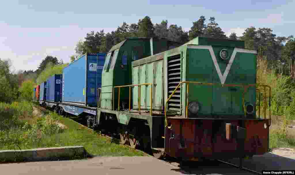 With a toot of the horn, the Odek factory train sets off. It's bound for the Klevan railway junction, seven kilometres from the factory. There the containers will be transferred to a freight train and hauled west along the main trunk line.