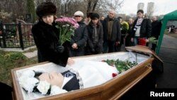 Nataliya Magnitskaya, mother of Sergei Magnitsky, grieves over her son's body during his funeral at a cemetery in Moscow in this photo from November 20, 2009.