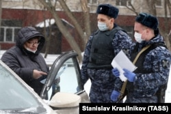 Russian security forces check a driver's ID during a coronavirus lockdown in Moscow on March 31.