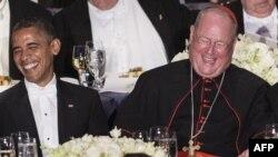 Președintele Barack Obama și cardinalul Timothy Dolan, arhiepiscop de New York, în 2012