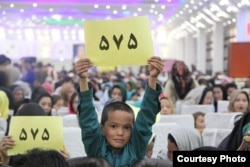 Zuhra Nawrozi's supporters attend an indoor rally in Kabul on October 12.