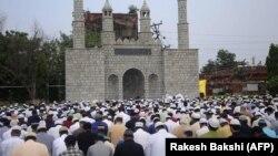 Muslims take part in Eid Al-Adha prayers in Jammu, Kashmir.