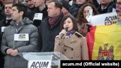 ACUM саясий блогунун лидерлери Майя Санду жана Андрей Нэстасе (ортодо).