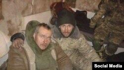 Вадим Ваврищук (слева) и капеллан «Назарей» в башне ДАПу, январь 2015 года