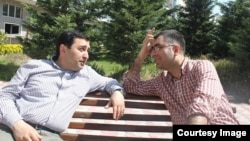 Anar Mammadli (right) was sentenced to 5 1/2 years in prison, while his deputy, Bashir Suleymanli (left), received a 3 1/2-year prison term.