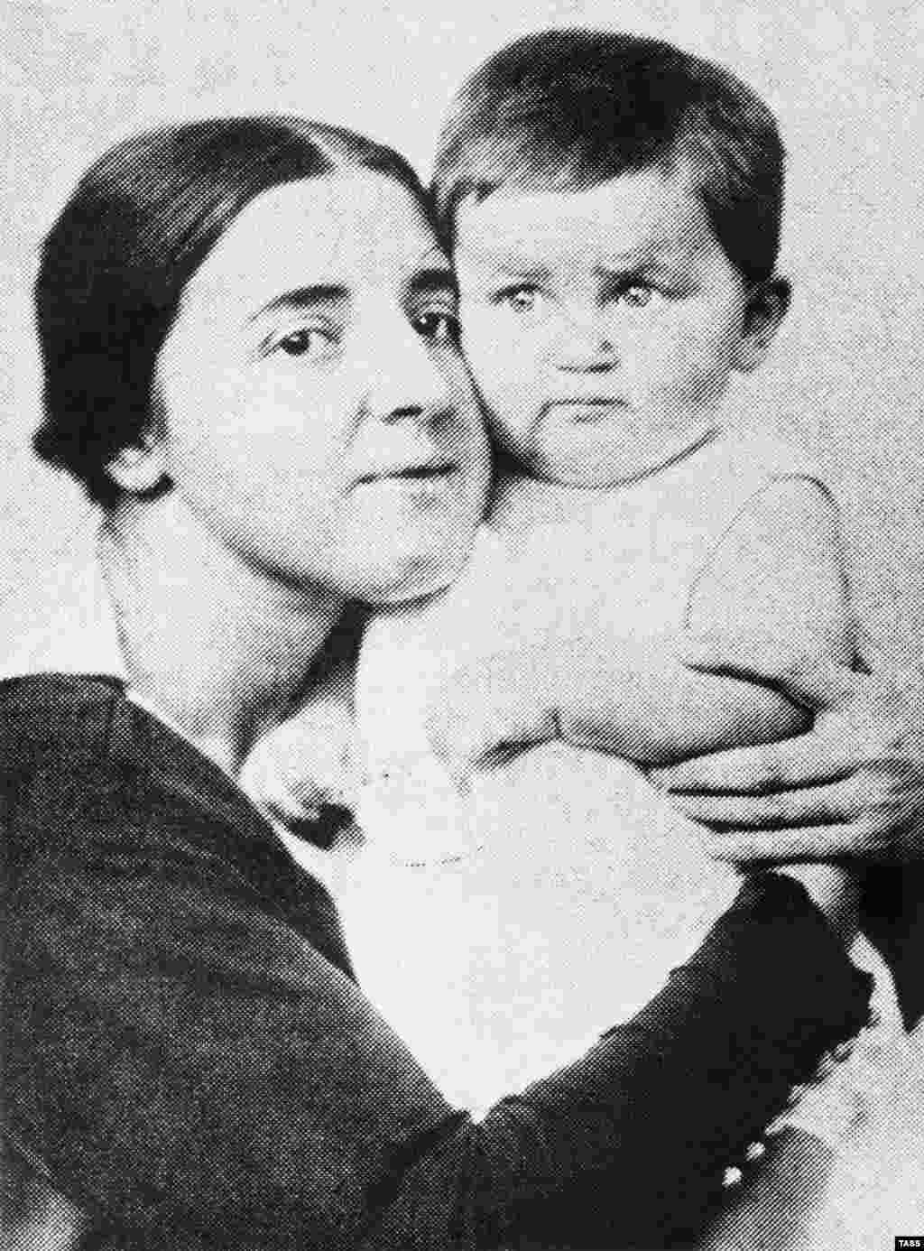 Nadezhda Alliluyeva, Josef Stalin's second wife, shown here with their son, Vasily, in 1922. The daughter of a revolutionary railroad worker, Alliluyeva met Stalin while he hid in her family's house in 1911. They married in 1919, when Stalin was 41 and Nadezhda was 18. Nadezhda died in 1932, officially of appendicitis. Some believe she committed suicide, while others contend that Stalin killed her. Vasily was born in 1921. He was a Soviet pilot during World War II and was made a general after the war. After Stalin died, Vasily was sentenced to eight years in prison. He was released in 1960. He was allowed to wear his uniform and medals. He died of alcholism in 1962 and was partially rehabilitated in 1999.