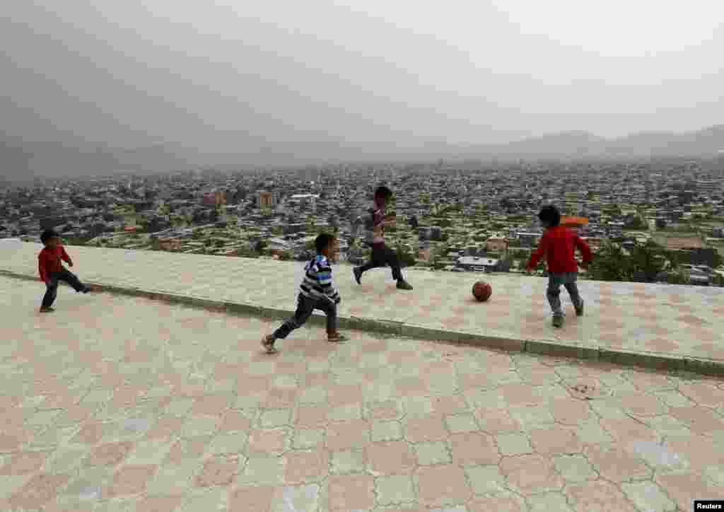 Afghan boys play soccer on a hilltop overlooking Kabul. (​AFP/Mohammad Ismail)