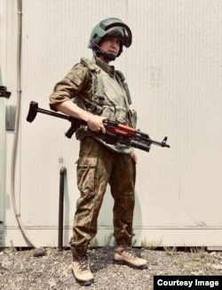 Hayato Sato dressed in the uniform of an FSB special forces fighter from the late 1990s, complete with a replica Kalashnikov fitted with a grenade launcher.