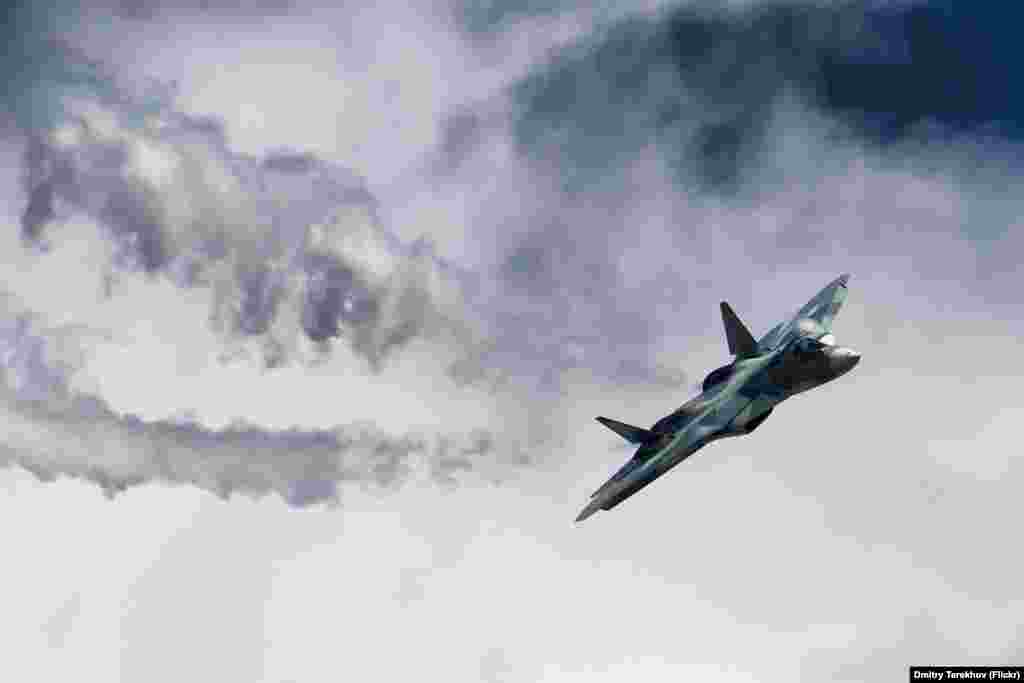 A Russian SU-57 swoops above an air-show crowd. The plane was touted as Russia's fifth-generation fighter -- a military term describing a jet's stealth, electronics, and the ability to serve different roles above the battlefield.