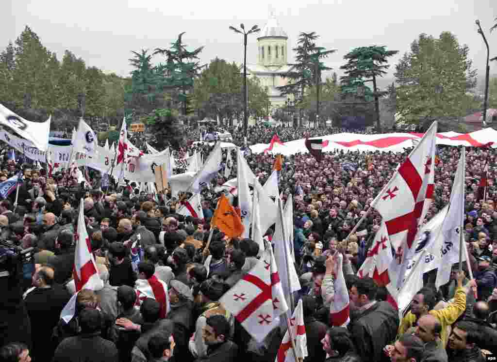 Some 8,000 Georgian opposition supporters stage a rally in the center of Tbilisi on November 8, 2003. The protesters say that Georgian government rigged the recent parliamentary elections and demand that President Eduard Shevardnadze be put on trial if the officials who falsified the results aren't fired.