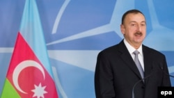 Belgium -- President of Azerbaijan, Ilham Aliyev, addresses the media prior to a North Atlantic Council (NAC) meeting at the NATO headquarters in Brussels, January 15, 2013