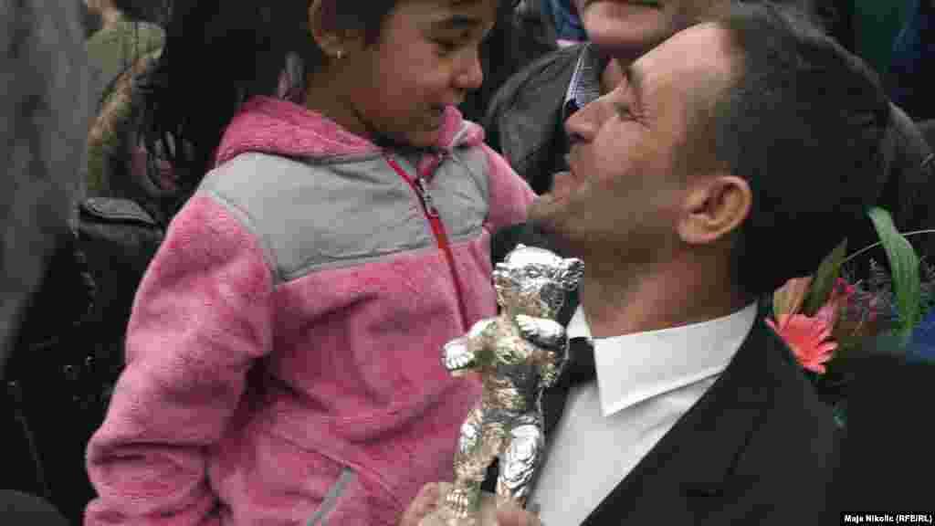 Mujic greets his daughter.