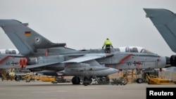 A technician works on a German Tornado jet at the air base in Incirlik.
