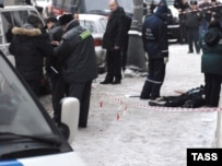 Stanislav Markelov and a journalist were shot by a single gunman on a Moscow street.