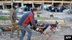 Жители эвакуируются из Хомса. 7 февраля 2014 года.