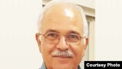 Farhang Amiri, 63, was murdered outside his home on September 26 2016 in the city of Yazd, Iran.