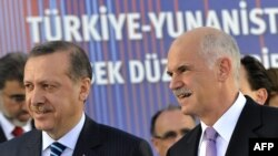A historic joint cabinet meeting was chaired by visiting Turkish Prime Minister Recep Tayyip Erdogan (left) and his Greek counterpart, George Papandreou.