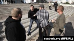 Plainclothes police detain journalists covering a protest action in Minsk on September 18.