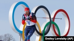 Russian cross-country skier Aleksandr Legkov races during the 2014 Winter Olympics in Sochi.