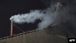 Vatican -- White smoke rises from the chimney on the roof of the Sistine Chapel, Vatican, 13Mar2013