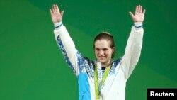 Бронзовый призер Олимпиады тяжелоатлетка из Казахстана Карина Горичева, выступающая в категории до 63 килограммов.