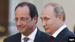 پوتین و اولاند در دیداری در سال گذشته در پاریس