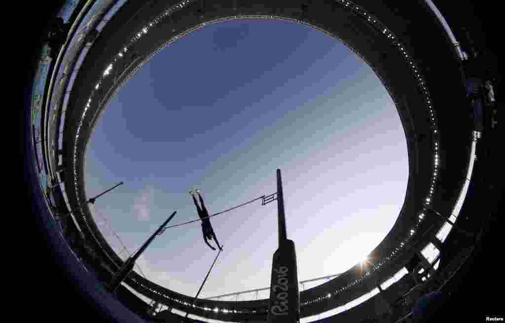 A fisheye view ofAshton Eaton of the United States clearing the bar in the men's decathlon pole vault final.