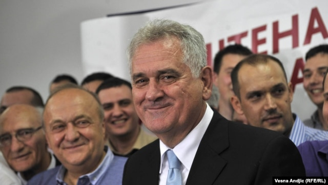 Serbian President-elect Tomislav Nikolic (foreground) celebrates his election victory with supporters in Belgrade.