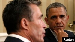 U.S. President Barack Obama watches as NATO Secretary-General Anders Fogh Rasmussen speaks in the Oval Office of the White House in Washington on May 31.