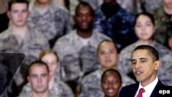 U.S. President Barack Obama greets U.S. troops during a rally at Osan Air Base, south of Seoul, today.